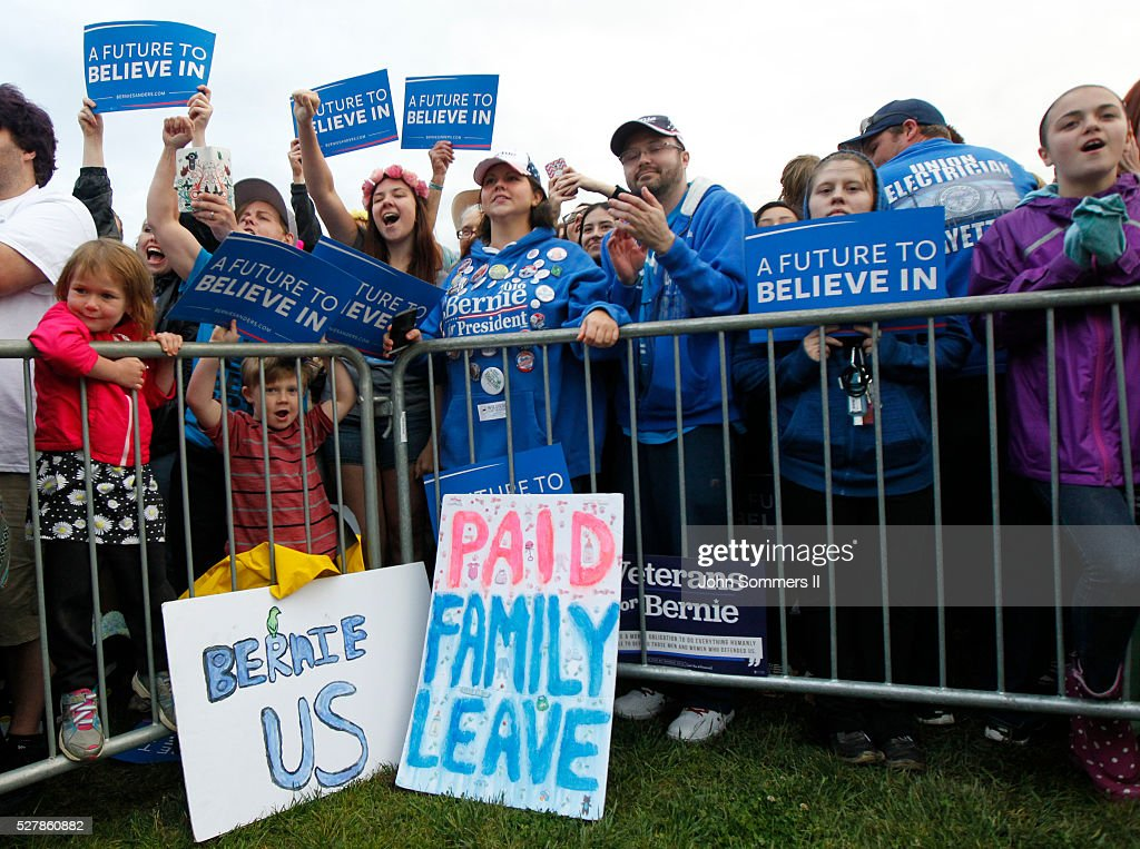 Campaign supporters show their support for Democratic presidential candidate Bernie Sanders as he speaks to them during a campaign rally at the Big Four Lawn park May 3, 2016 in Louisville, Kentucky. Sanders is preparing for Kentucky's May 17th primary.