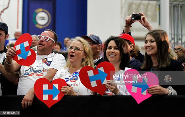 Campaign supporters shows their support for Democratic presidential candidate Hillary Clinton during a campaign stop at the Union of Carpenters and...