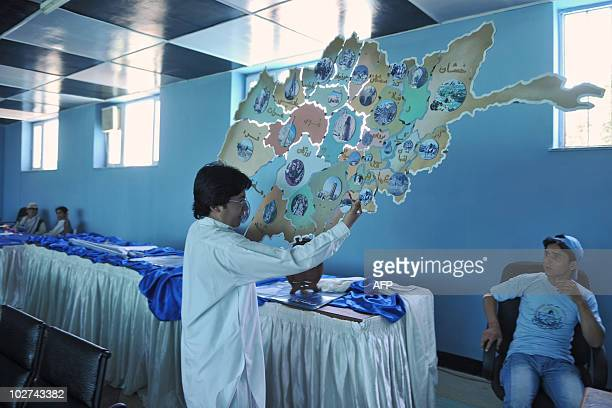 A campaign team member of Afghan parliamentary election candidate Farkhunda Zahra Naderi the daughter of Afghan spiritual Ismaili religious leader...