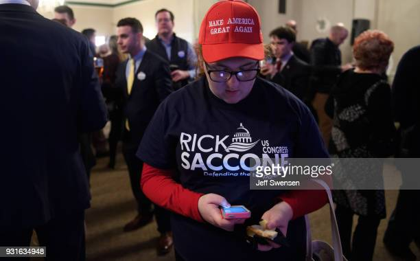 Campaign volunteer Chloe Chappell checks early election results at an Election Night event for GOP PA Congressional Candidate Rick Saccone as the...