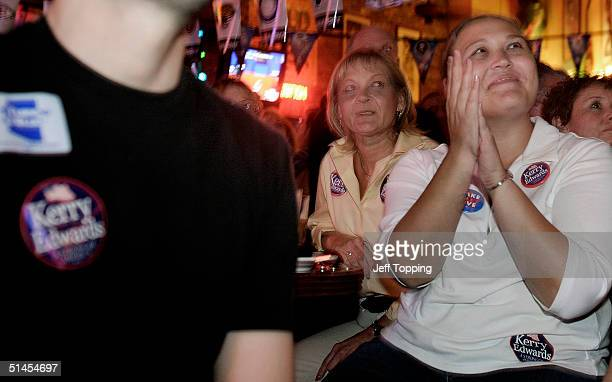 Campaign volunteers Jessica Brown and Cathy Accomando watch their candidate John Kerry debate President George W Bush in St Louis October 8 2004 at a...