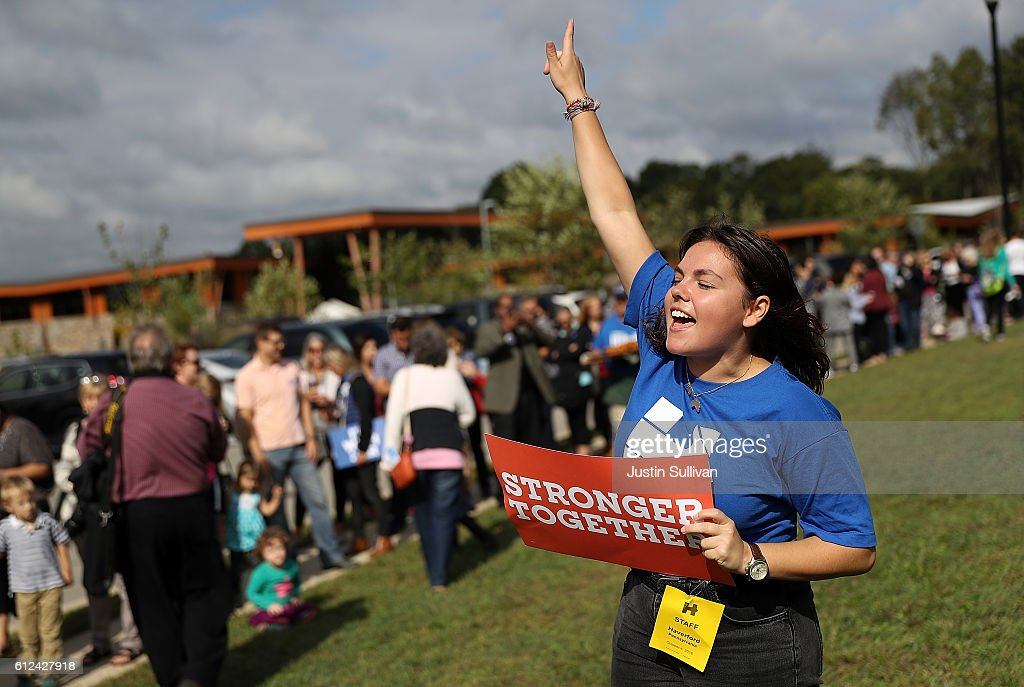 A campaign worker cheers as people wait in line to enter a Family Town Hall event with democratic presidential nominee former Secretary of State Hillary Clinton at Haverford Community Recreation and Environmental Center on October 4, 2016 in Haverford, Pennsylvania. Hillary Clinton is campaigning in Pennsylvania.