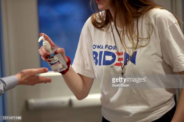 A campaign worker offers hand sanitizer to guests at a rally with Democratic presidential candidate former Vice President Joe Biden at Renaissance...