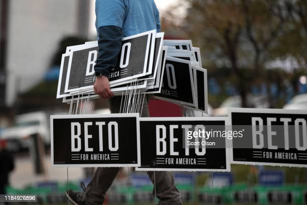 Campaign workers for Democratic presidential candidate former Rep Beto O'Rourke collect campaign signs after learning O'Rourke was dropping out of...