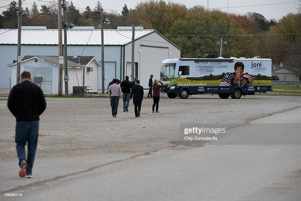 Campaign workers for Republican U.S. Senate candidate Joni Ernst walk back to her campaign RV after Ernst cast her ballot on election day in her hometown November 4, 2014 in Red Oak, Iowa. According to the polls, Ernst is in a neck-and-neck race with her opponent, Democratic candidate Rep. Bruce Braley (D-IA), and the election in Iowa could decide which party controls the U.S. Senate.