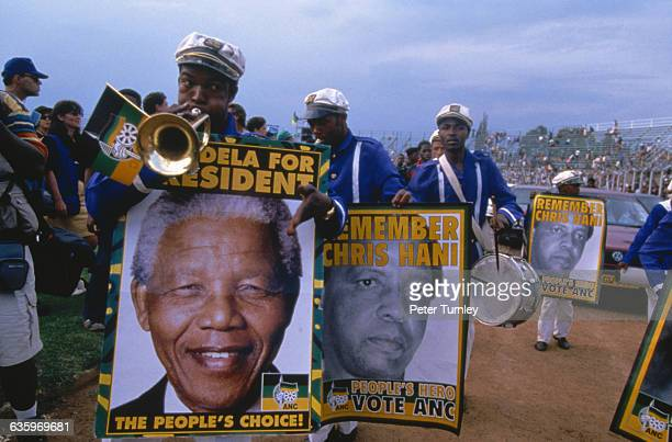 Campaign workers play music and carry posters of Mandela They also carry posters in memory of the late Chris Hani who was assassinated in 1993
