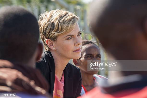AIDS campaigner and actress Charlize Theron visits a Youth Ambassador Project funded by the Global Fund to Fight AIDS Tuberculosis Malaria at the...