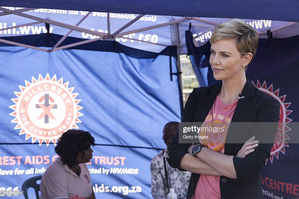 AIDS campaigner and actress Charlize Theron visits a Youth Ambassador Project funded by the Global Fund to Fight AIDS, Tuberculosis & Malaria at the Malangeni Thusong Centre, on August 2, 2013 in the Ugu district of KwaZulu Natal, South Africa. Charlize Theron spoke with beneficiaries of the Youth Ambassador Program, joined group discussions and refereed a soccer match between ambassadors and beneficiaries of the project to help prevent the spread of HIV. The program, supported by the Global Fund to Fight AIDS, Tuberculosis and Malaria, trains young men and women in KwaZulu Natal province to disseminate HIV prevention messages by engaging with youth in schools, support groups, churches, at sport events and in their homes.