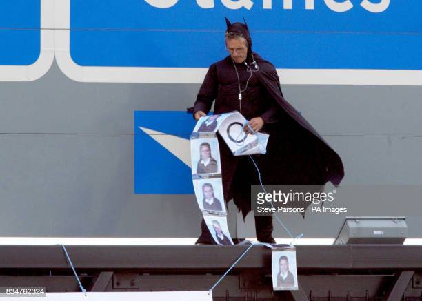Campaigner, believed to be linked to Fathers 4 Justice, dressed as Batman on a gantry over the M25 near Heathrow Airport, London.