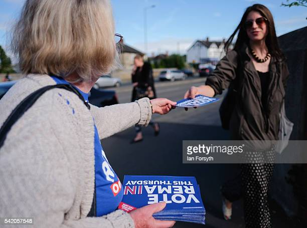 Campaigner Bernie Bonner from the Stronger In campaign distributes campaign leaflets at Cross Gates Station on June 22 2016 in Leeds England The...