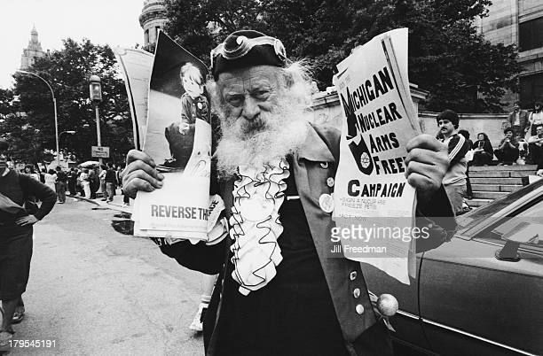 A campaigner carries pamphlets for the 'Michigan Nuclear Arms Free Campaign' at a peace rally in New York City 1982