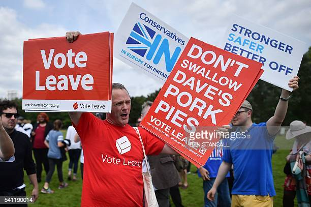 Campaigner for 'Vote Leave', the official 'Leave' campaign organisation, holds a placard during a rally for 'Britain Stronger in Europe', the...