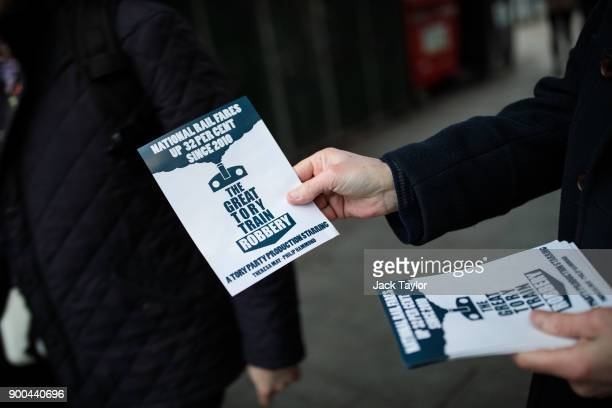 A campaigner hands out leaflets about rail fare increases to commuters outside East Dulwich Station on January 2 2018 in London England The average...