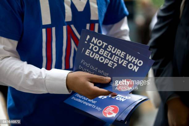 A campaigner hands out leaflets for 'Britain Stronger in Europe' the official 'Remain' campaign group seeking to avoid a Brexit outside Waterloo...