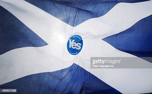 YES campaigner sticker adorns a Scottish Saltire flag on September 16 2014 in Glasgow Scotland Yes and No supporters are campaigning in the last two...