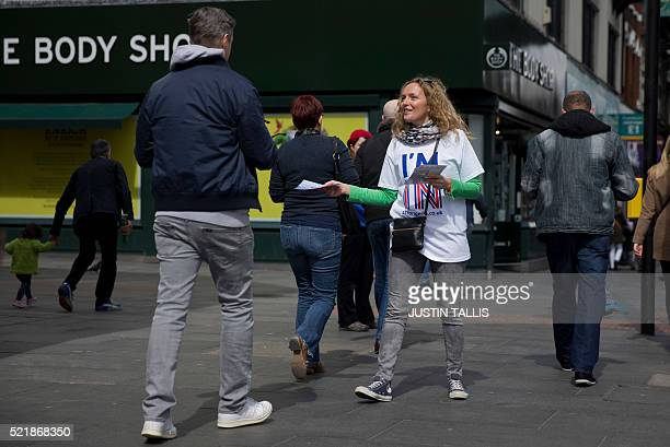 A campaigner with the 'Britain Stronger In Europe' hands out leaflets in Brixton south London on April 17 calling for a remain vote in the upcoming...