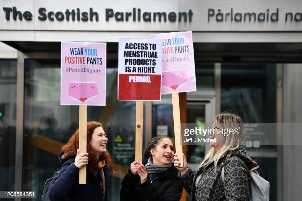 Campaigners and activists rally outside the Scottish Parliament in support of the Scottish Governments Support For Period Products Bill on February...