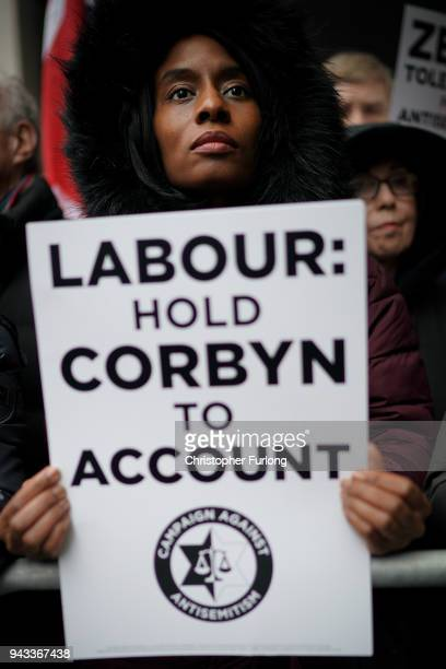 Campaigners from the Campaign Against Antisemitism demonstrate and listen to speakers outside the Labour Party headquarters on April 8 2018 in London...
