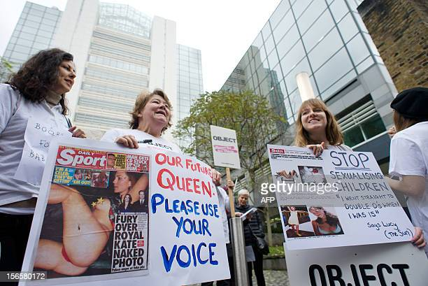 Campaigners from the OBJECT and Turn Your Back On Page 3 groups hold placards to protest over the Sun newspaper's daily photos of topless female...
