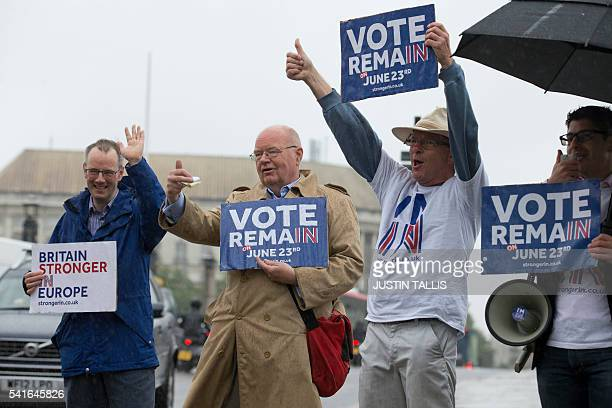 Campaigners hold placards for 'Britain Stronger in Europe' the official 'Remain' campaign group seeking to avoid a Brexit ahead of the forthcoming EU...