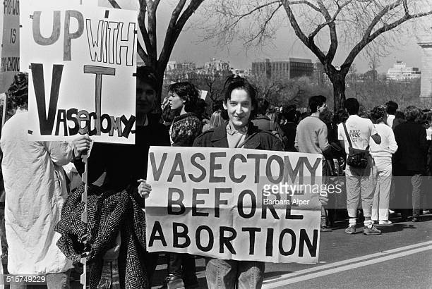 Campaigners holding placards advocating birth control through vasectomy at a National March For Women's Lives in Washington DC 9th March 1986
