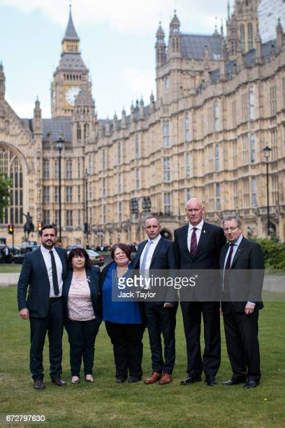 Campaigners Lawyer Matt Jury Judith Jenkins her daughter Sarahjane Young Mark Tipper survivor Simon Utley and Danny Kinahan MP pose for a photograph...