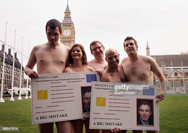 NO2ID campaigners pose for photographers on Parliament Square on October 18 2005 in London NO2ID are an organisation opposed to the government's...