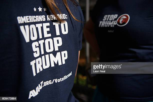 Campaigners pose for photographs as the Stop Trump campaign bus takes to the road urging American expats across the UK to register and vote in the US...