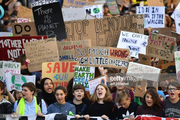 Campaigners protest during a climate change action day on September 20, 2019 in Edinburgh, Scotland. Protests are taking place today worldwide, with...