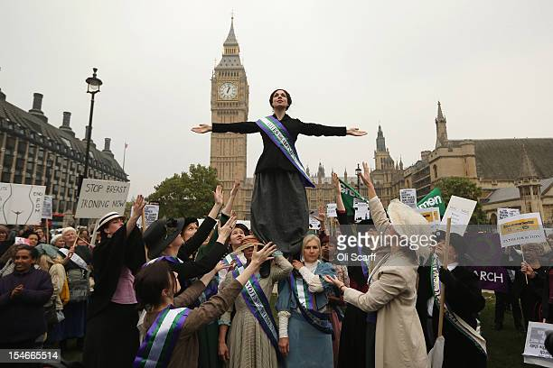 Campaigners some dressed as suffragettes attend a rally organised by UK Feminista to call for equal rights for men and women on October 24 2012 in...