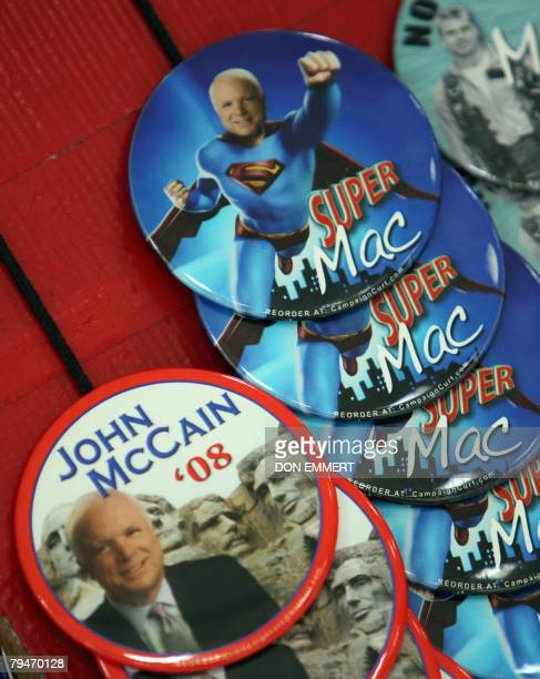 Campaigns buttons for Presidential hopeful John McCain are on sale as he attends a campaign rally 01 February 2008 in St Louis Missouri McCain holds...