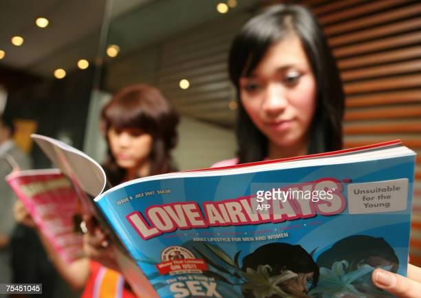 Campaing girls are seen reading the 'Love Airways' magazine during a mobile phone text sex education campaign the first of its kind in the world's...