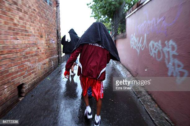 Campbell Cobbo Riley walks between the Tony Mundine Gym and the tent set up for his bout in Night Of The Black Stars on February 13 2009 in the...