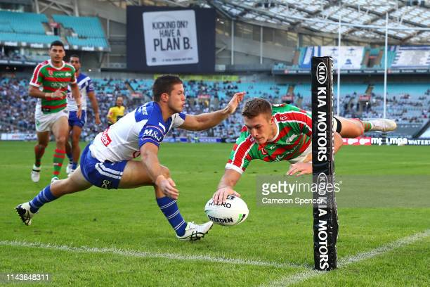 Campbell Graham of the Rabbitohs scores a try during the NRL round six match between the Bulldogs and the South Sydney Rabbitohs at ANZ Stadium on...