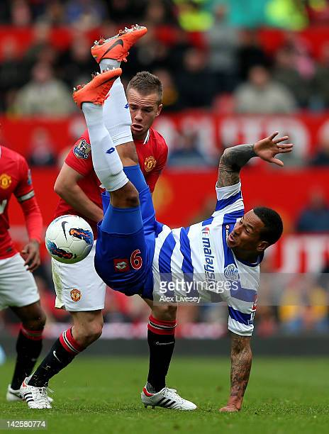 Campbell of Queens Park Rangers tangles with Tom Cleverley of Manchester United during the Barclays Premier League match between Manchester United...