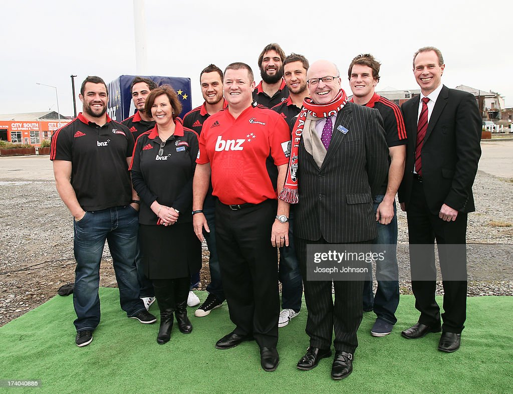 Campbell Parker BNZ Head of Business Banking and Philip Aldridge Chairman of BNZ partners Canterbury. Corey Flynn, Zac Guildford, Israel Dagg, Sam Whitelock, Tom Taylor and Matt Todd Crusaders players with Hamish Riach Crusaders CEO after a media announcement that BNZ will be naming rights sponsor of the Crusaders held on the old Turners and Growers land on July 19, 2013 in Christchurch, New Zealand.