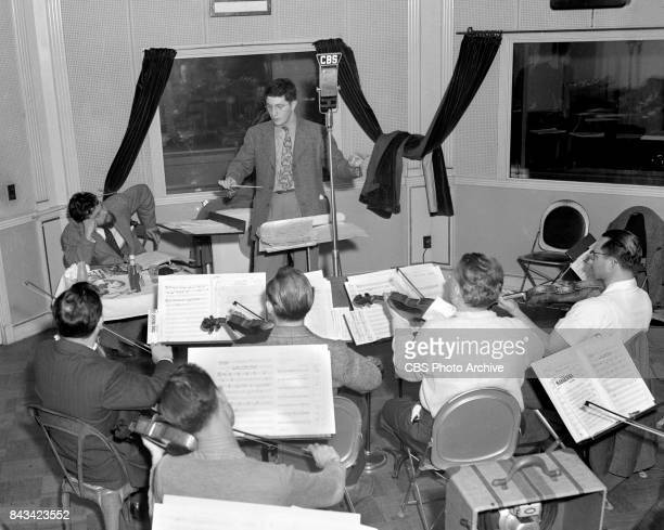 Campbell Playhouse radio production and rehearsal of The Hurricane directed by Orson Welles At rear left Orson Welles director seated with lunch...