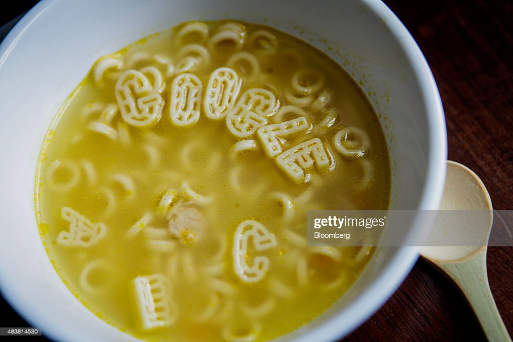 Campbell Soup Co. letters spell out the word 'Google' in a bowl in this arranged photograph taken in New York U.S., on Wednesday, Aug. 12, 2015. Google Inc. rose as much as 6.5 percent after reorganizing into a holding company called Alphabet Inc., breaking out its main Web operations from ambitious new endeavors such as research lab Google X and Calico, which seeks to extend human lives. The structure, announced Monday, will give greater clarity into how Google invests in various ventures, including driverless cars, high-speed Internet service and health-related technologies. Photographer: Chris Goodney/Bloomberg via Getty Images
