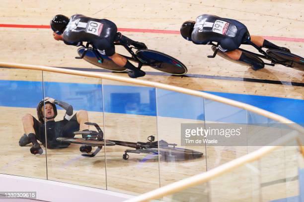 Campbell Stewart and Jordan Kerby of Team New Zealand sprint as Regan Gough of Team New Zealand falls during the Men's team pursuit finals, bronze...