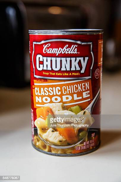 Campbell's Chunky Classic Chicken Noodle Soup prepared and ready to heat and serve for lunch or dinner meals Red classic label shows soup in can with...