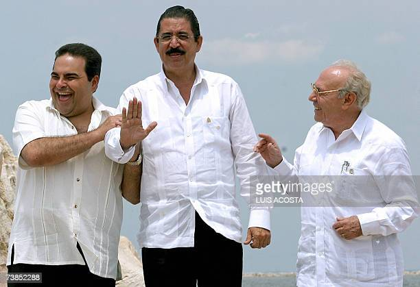The presidents Antonio Saca of El Salvador and Manuel Zelaya of Honduras and Jaime Morales Carzo Vicepresident of Nicaragua joke during the family...