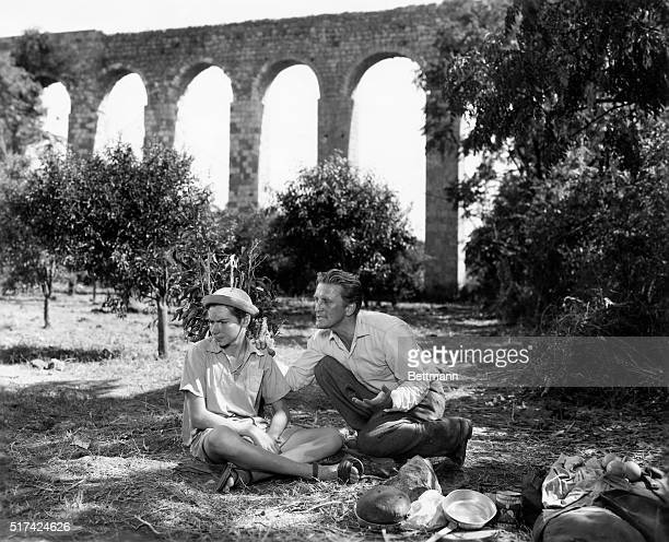 Camped near an old Turkish aqueduct in Israel, Yehoshua, , is consoled by Hans Muller, , when he thinks of his parents who were lost in the recent...