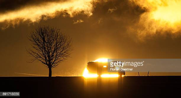 A camper is captured in front of the sunset on Februar 07 2015 in Stadtallendorf Germany