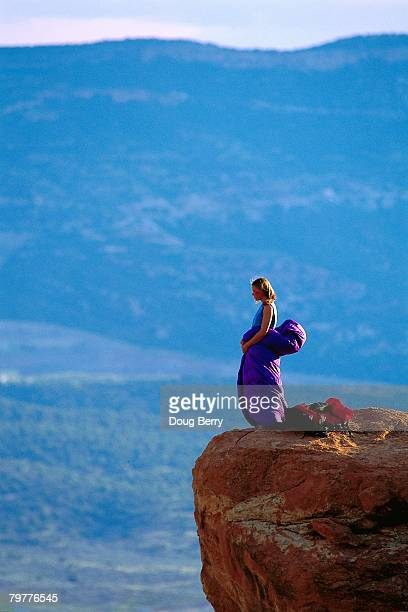camper standing at edge of cliff - escarpment stock pictures, royalty-free photos & images