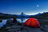 Camper under full Moon at Matterhorn