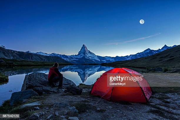 camper under full moon at matterhorn - snow moon stock pictures, royalty-free photos & images
