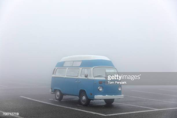 Camper van in foggy parking lot