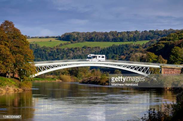 Camper van travels from the England to Wales over Bigsweir Bridge which spans the River Wye between Wales and England on October 15, 2020 in...