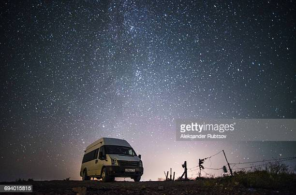camper van under starry sky - mini van stock photos and pictures