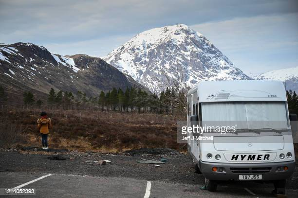 Camper vans are parked up at Glen Coe as members of the public are asked to stop traveling to the Scottish Highlands in a bid to avoid spreading the...